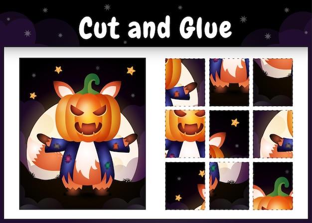 Kinderbrettspiel schneiden und kleben mit einem süßen fuchs im halloween-kostüm Premium Vektoren