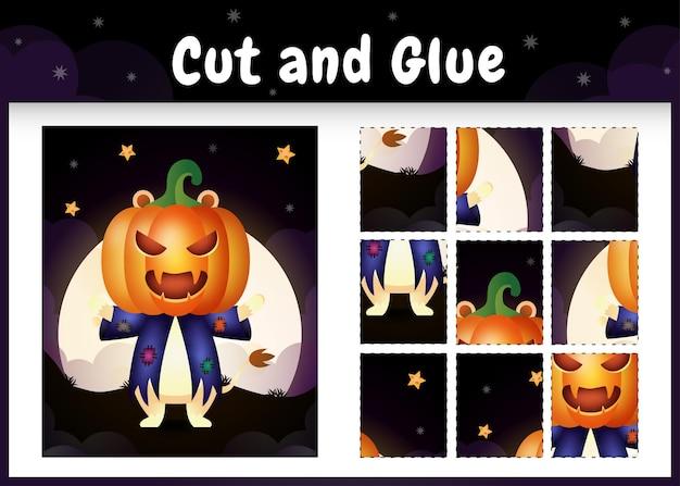 Kinderbrettspiel schneiden und kleben mit einem süßen löwen im halloween-kostüm