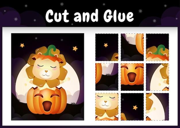 Kinderbrettspiel schneiden und kleben mit einem süßen löwen im halloween-kürbis