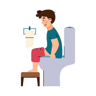 Kinderjunge, der auf toilette im badezimmer eine flache karikaturvektorillustration sitzt