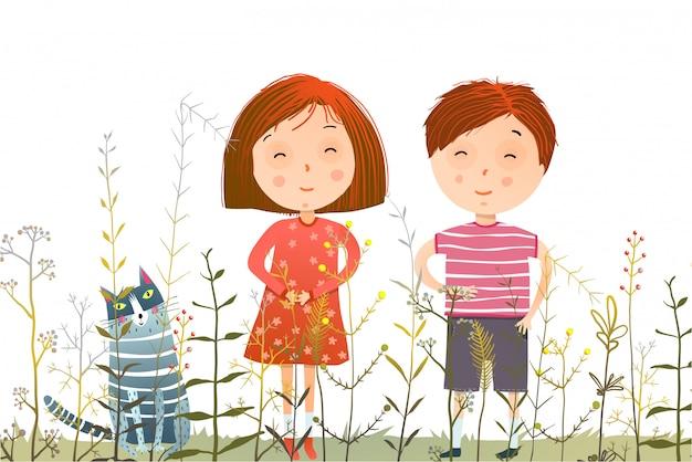 Kinderjungenmädchen und -katze im grasfeld