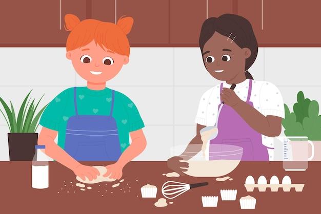 Kinderkoch bäcker beruf kinder in schürzen kochen in der küche cupcakes backen