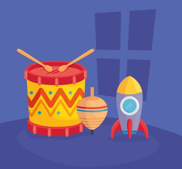 Kinderspielzeug, trommel mit rakete und spinnspielzeug