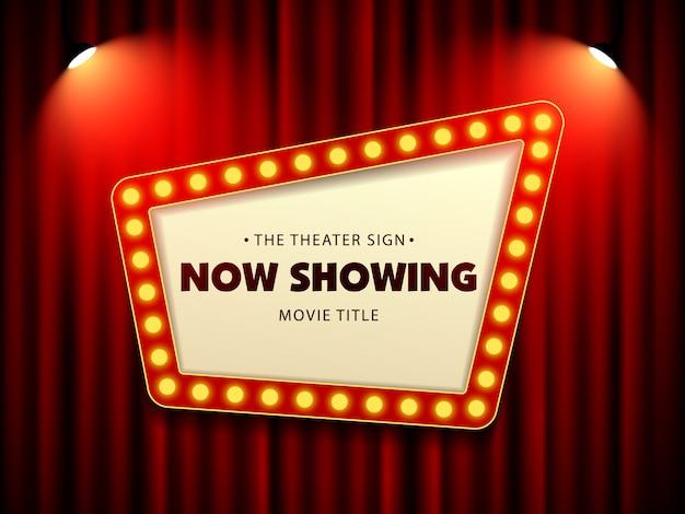 Kino-theater-retro- zeichen auf vorhang mit scheinwerfer