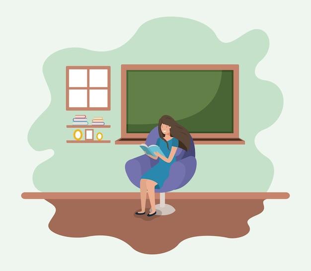 Klassenzimmer mit weiblichem lehrerlesebuch im sofa