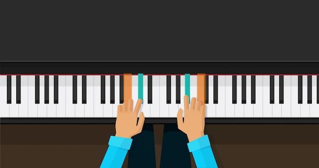 Klaviertasten mit den personenhänden, die spielakkorde lernen