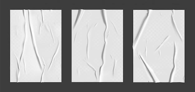 Klebepapier mit nassem transparentem falteneffekt auf grauem hintergrund. weißes nasses papierplakatschablonenset mit zerknitterter textur. realistische plakate
