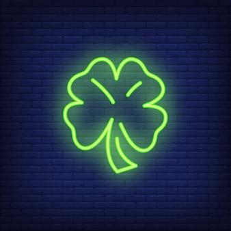 Klee-leuchtreklameelement mit vier blättern. vermögenskonzept für helle werbung der nacht