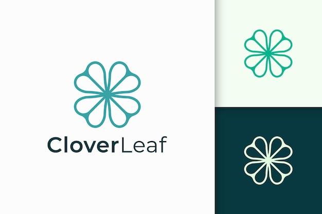Klee-logo in einfacher linie und liebesform steht für glück