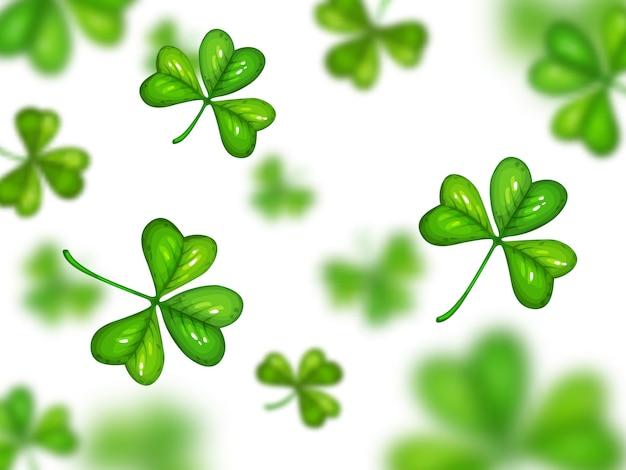 Kleeblatt auf weißem hintergrund mit unscharfem effekt. st. patrick tag symbol, karikatur grüner klee zufällig fliegen auf weißem hintergrund. keltisches traditionelles glückskleeblatt, kleeblattmuster oder verzierung