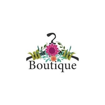 Kleiderbügelkonzept mit blumen für eine boutique-logo-vorlage