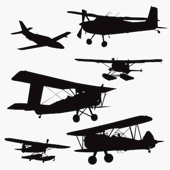 Kleine flugzeug-silhouetten