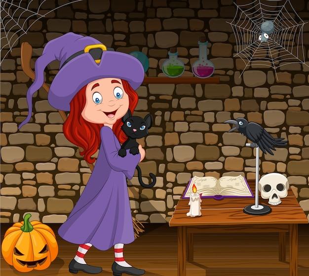 Kleine hexe der karikatur, die schwarze katze im raum umarmt