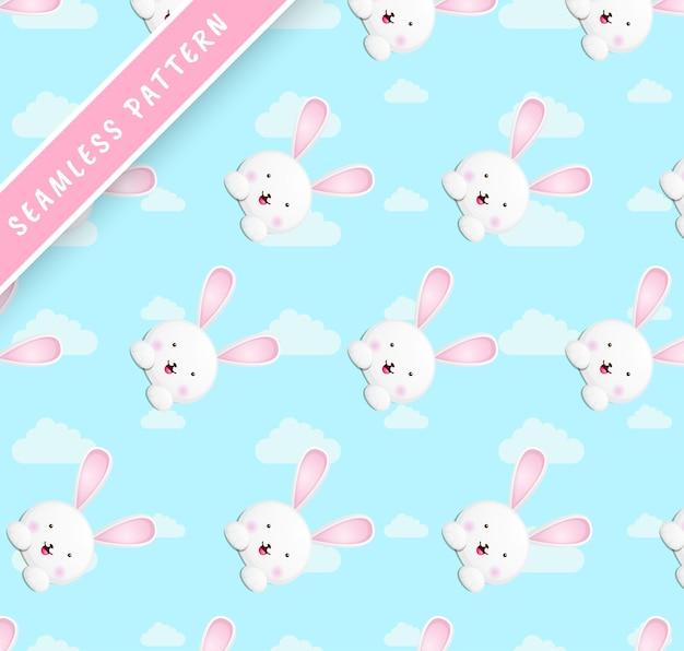 Kleine kaninchenköpfe und wolkenmuster Premium Vektoren