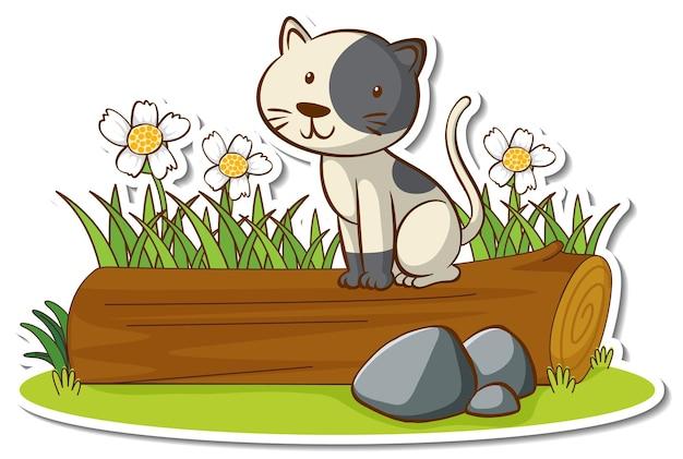 Kleine katze, die auf einem baumstammaufkleber sitzt