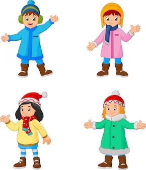 Kleine mädchen der karikatur, die winterkleidung tragen