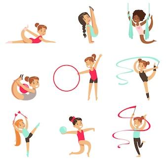 Kleine mädchen, die gymnastik- und akrobatikübungen im klassensatz der zukünftigen sportprofis machen