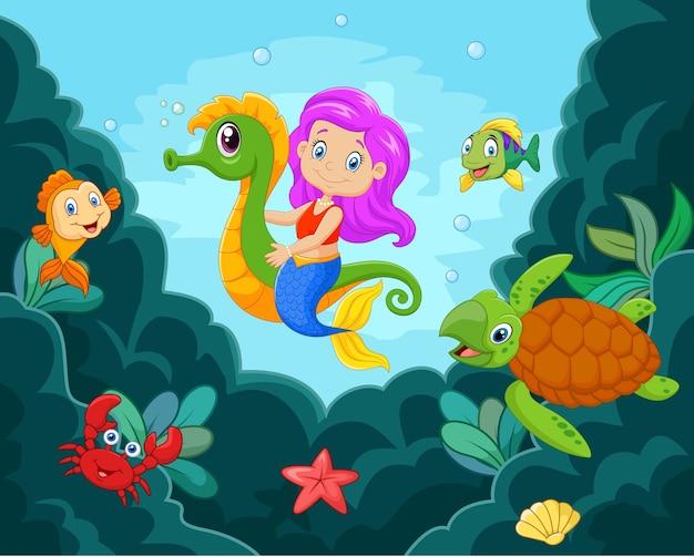 Kleine meerjungfrau der karikatur, die mit seahorse spielt