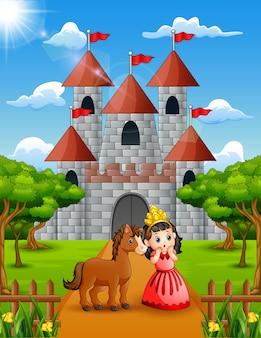 Kleine prinzessin und pferd stehen vor dem schloss
