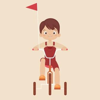 Kleiner junge, der ein fahrrad mit drei rädern fährt
