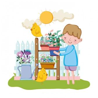 Kleiner junge, der houseplant mit küken anhebt