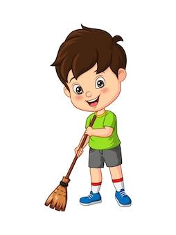 Kleiner junge der karikatur, der auf dem boden fegt