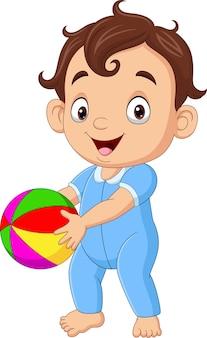 Kleiner junge der karikatur, der bunten ball hält