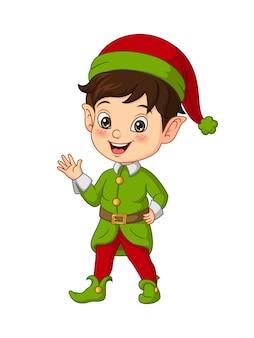 Kleiner junge der karikatur, der weihnachtselfenkostüm trägt
