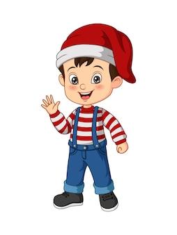 Kleiner junge der karikatur, der weihnachtskostüm trägt