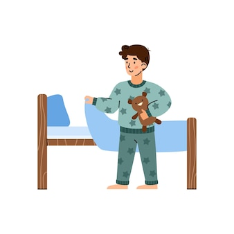 Kleiner junge im pyjama, der cartoon-vektor-illustration isoliert schlafen geht