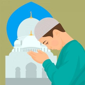 Kleiner junge in der moschee betend