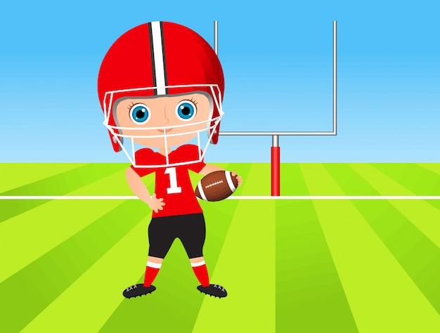 Kleiner junge. kind, das amerikanischen fußball spielt.