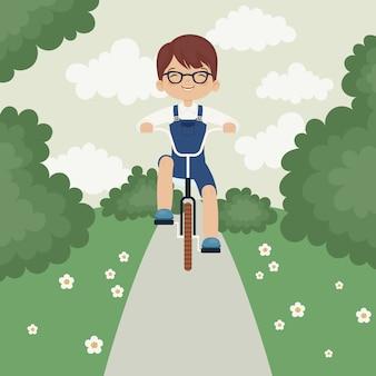 Kleiner junge mit dem fahrrad