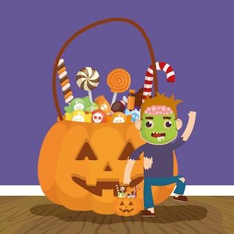 Kleiner junge mit zombieverkleidung und süßigkeitskürbis