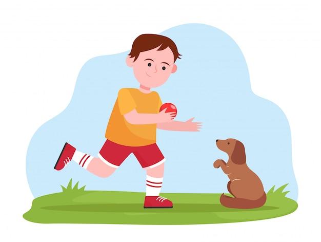 Kleiner junge spielt mit hund