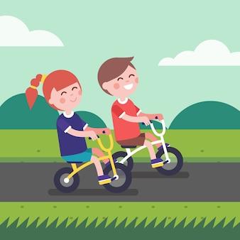 Kleiner junge und mädchen kinder fahrrad fahren