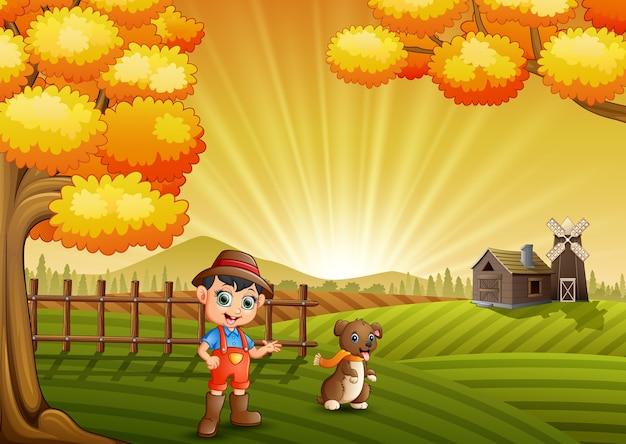 Kleiner landwirt der karikatur mit seinem hund im bauernhofhintergrund