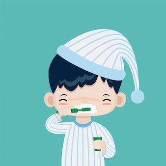 Kleiner netter junge glücklich zum putzen seiner zähne, vektorkarikatur