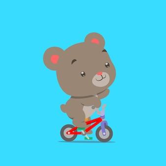 Kleiner teddybär, der mit dem kleinen bunten fahrrad radelt