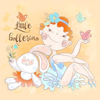 Kleines ballerinamädchen mit einem häschenspielzeug.