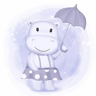 Kleines flusspferd-mädchen holen regenschirm