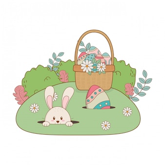 Kleines kaninchen mit dem ei gemalt im korb auf dem garten