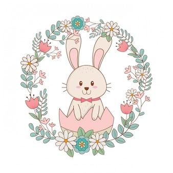 Kleines kaninchen mit ei gemalt und blumen