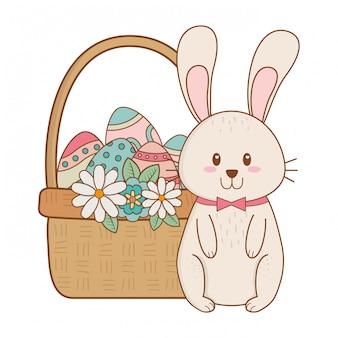 Kleines kaninchen mit ei malte ostern im korb