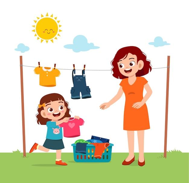 Kleines kind hilft mutter, die kleidung draußen zu trocknen Premium Vektoren