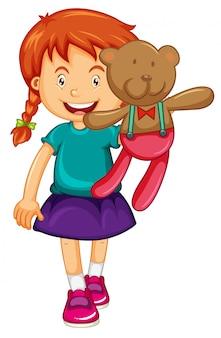 Kleines mädchen, das braunen teddybär hält