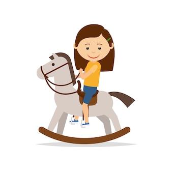 Kleines mädchen, das ein spielzeugpferd reitet