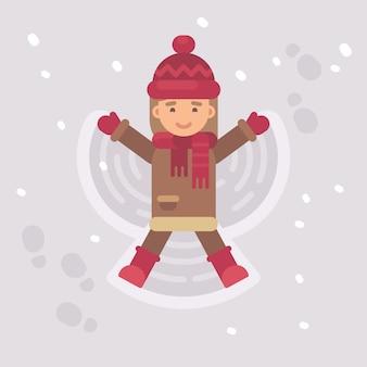 Kleines mädchen, das einen schneeengel macht
