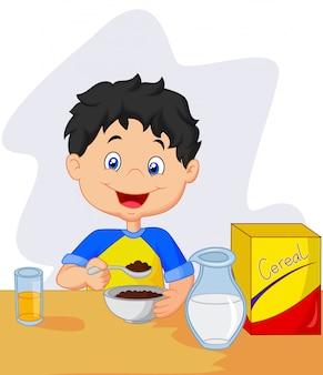 Kleines mädchen, das frühstückscerealien mit milch hat