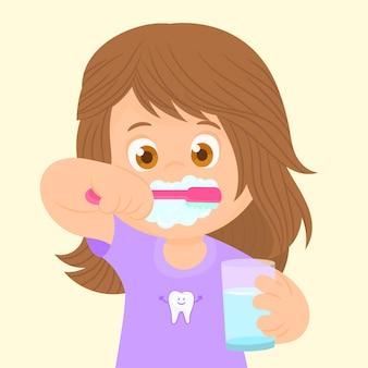 Kleines mädchen, das ihre zähne putzt